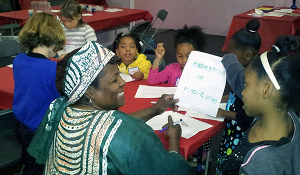 "Charlotte ""Sista C"" Ferrell works with children to create peace and love poems then deputizes them as Ambassadors of Peace and Love"