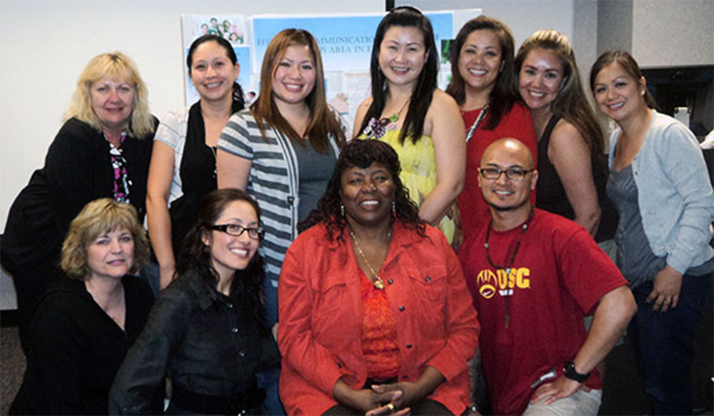 "Charlotte ""Sista C"" Ferrell with students of her University of Phoenix Healthcare Capstone class."